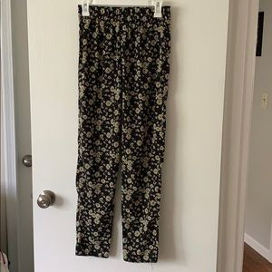 Black and daisy patterned flowy pants